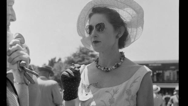 When smoking was cool, circa 1955. An unidentified woman with a cigarette at the Trentham races, Upper Hutt.