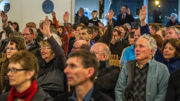 A show of hands at a public meeting in Christchurch to see who will support a petition calling for an inquiry into ...