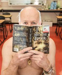 Author Ted Dawe with a copy of his banned book, Into the River.