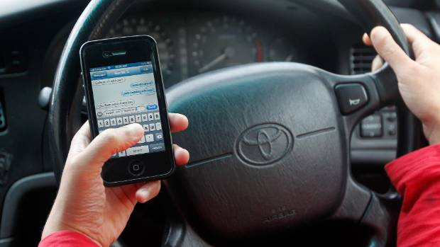 During a two-hour police operation in Melbourne, 53 people were caught using mobile phones while driving.