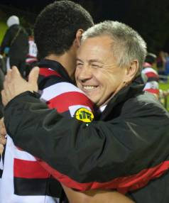 Milton Haig as assistant coach of the Counties Manukau Steelers in 2010, he is embracing Siale Piutau after the team's ...