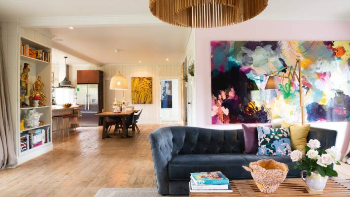 A Large Scale Abstract Painting Acts As A Focal Point In This Stylishly  Designed Living