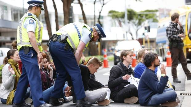 Anti-TPPA protesters were arrested after blocking Wellington's Lambton Quay during a rally outside the Ministry of ...