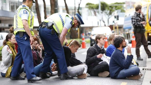 Anti TPPA protesters are arrested by police after blockading Lambton Quay during there protest outside the Ministry of ...