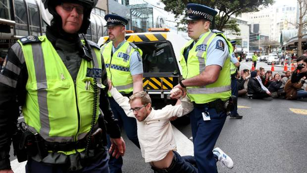 Police arrest a protester outside the MFAT building in Wellington in September.