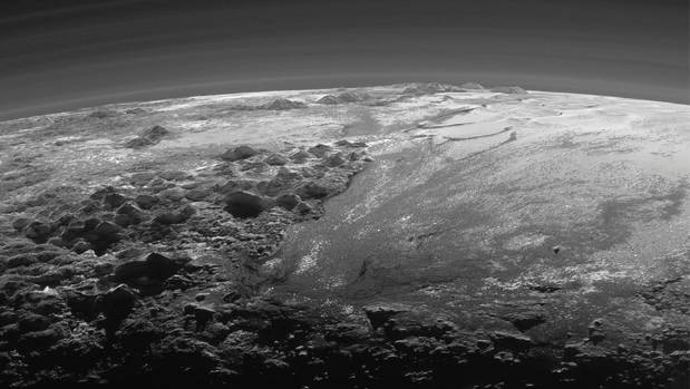 A close-up view of the rugged, icy mountains and flat ice plains on Pluto is seen in an image from Nasa's New Horizons ...