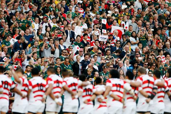 Japan's players face fans from both sides ahead of their match with South Africa.