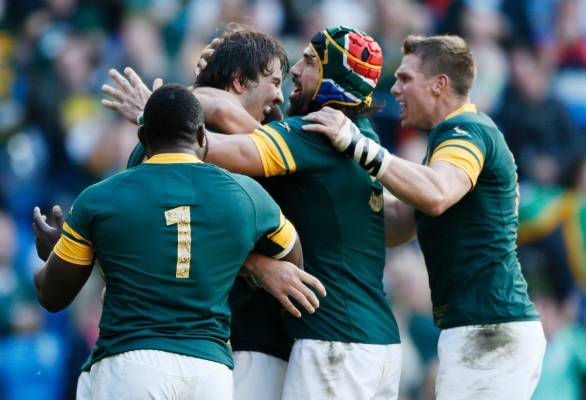 South Africa's Lood de Jager, second left, celebrates scoring their third try against Japan.
