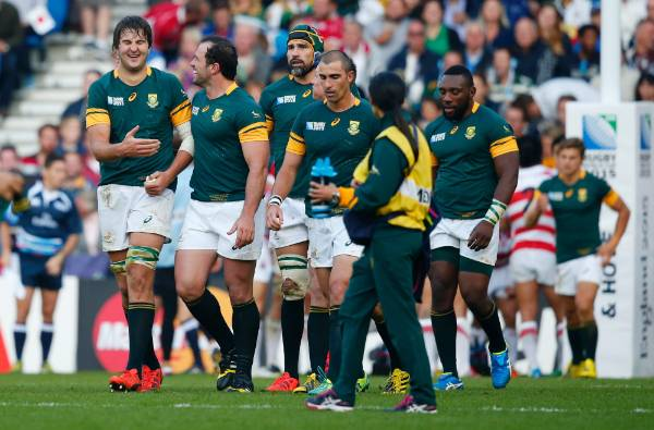 South Africa's Lood de Jager, left, celebrates scoring a try with Bismarck du Plessis.