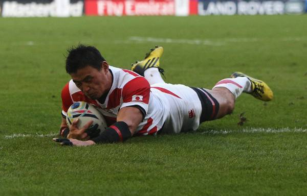 Japan's Ayumu Goromaru dives over to score his team's second try against the Springboks in Brighton.