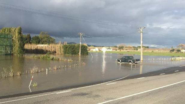 A 4WD submerged in flood waters on corner of State Highway 2 and Plimmer Rd, 7km north of Gisborne.