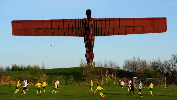Antony's Gormley Angel of the North sculpture overlooks a football match in Gateshead, England.
