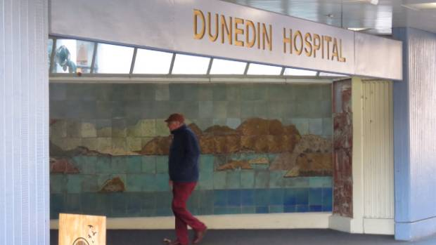 A patient walks inside Dunedin Hospital.