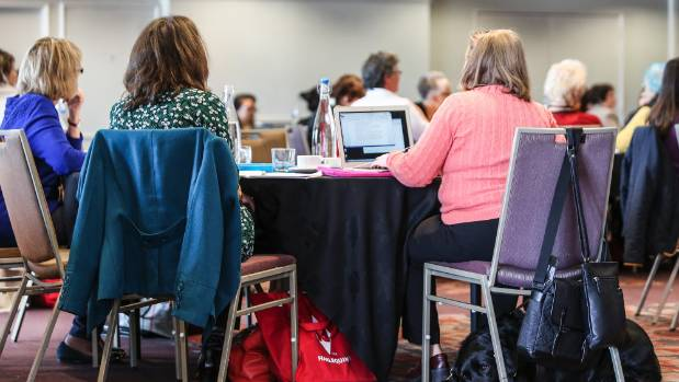 Conference-goers take notes during Candace Havens' presentation