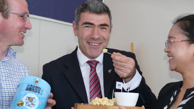 Primary Industries minister Nathan Guy tries some cheese made at the Blue River Dairy plant in Invercargill as the ...