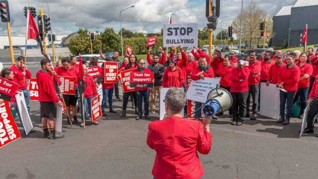 Workers from Auckland Bunnings stores deliver a strike notice to Bunnings' head office.
