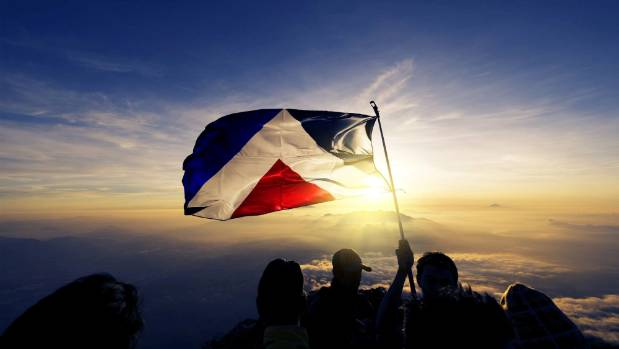 The Red Peak flag, designed by Aaron Dustin, found a following on social media.