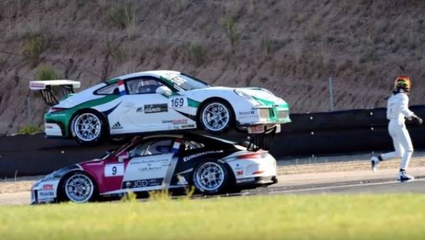Racing Drivers Pile Their Porsche Carreras On Top Of Each