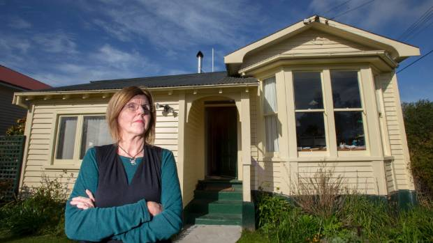 Jennifer Dalziel believes her house is still sinking into her TC3 land despite EQC repairing her foundations twice.