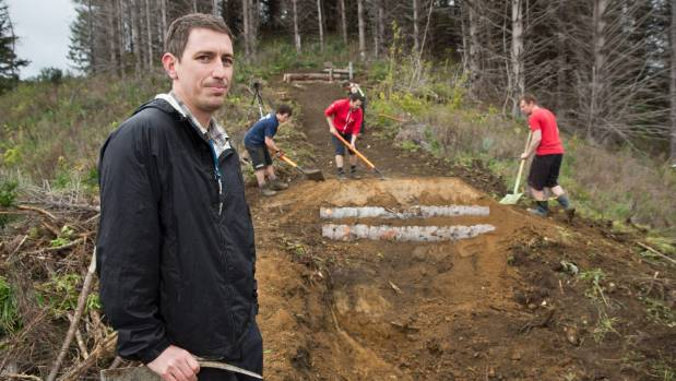 Nelson Mountain Bike Club committee member Mark Newton with others working on building a new track at Codgers Mountain ...