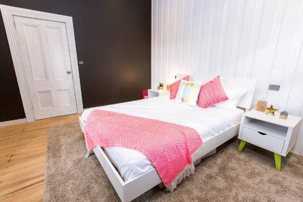 "Jamie and Hayden took a risk with some bold colours for their ""urban street"" guest room."
