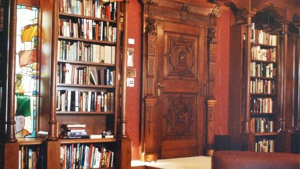 The library of the original Ravenscar House in Scarborough with 1650 carved door. Window by Christchurch glass artist ...