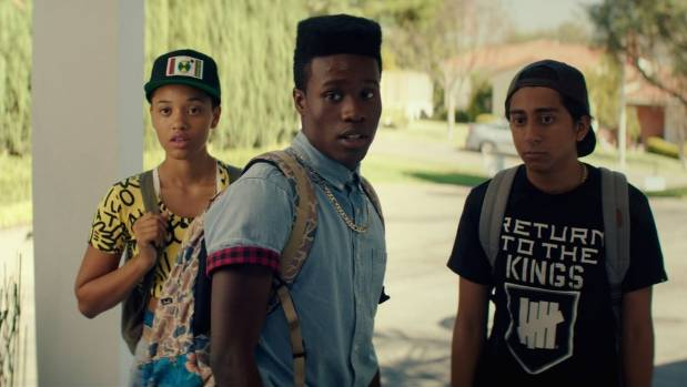 A scene from Dope, starring Shameik Moore as Malcolm (C).