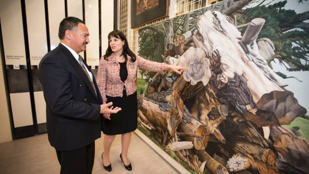 Trust Waikato chairman Niwa Nuri and Hamilton Mayor Julie Hardaker discuss artist Dick Frizzell's work Pile of Stumps.