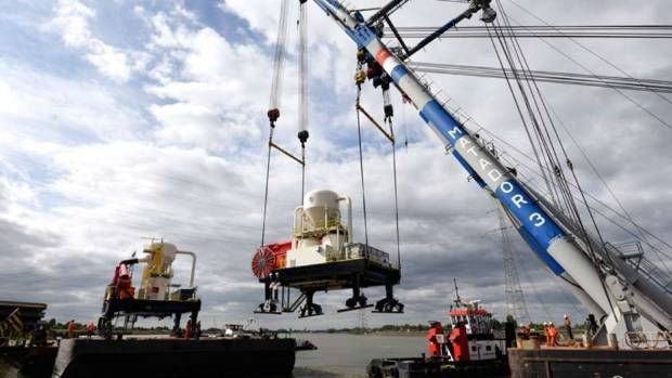 Concrete company Holcim's new cement ship unloaders are placed onto a barge in Rotterdam in the Netherlands, their first ...
