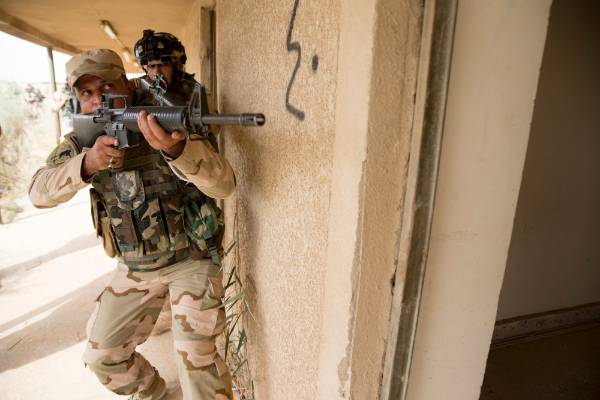 Iraqi troops are seen training in urban clearances and tactics.