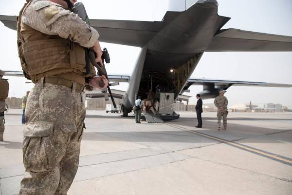 Troops work around the plane at Camp Taji.