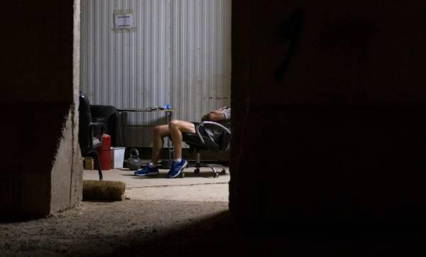 A soldier rests at Camp Taji.
