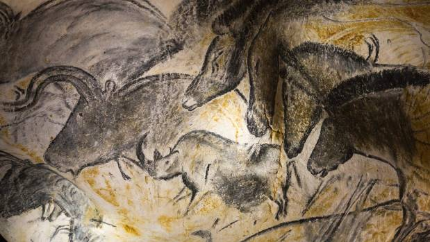 A replica of pre-historic drawings showing horses, rhinoceros and aurochs is seen on a wall at the site of the Cavern of ...