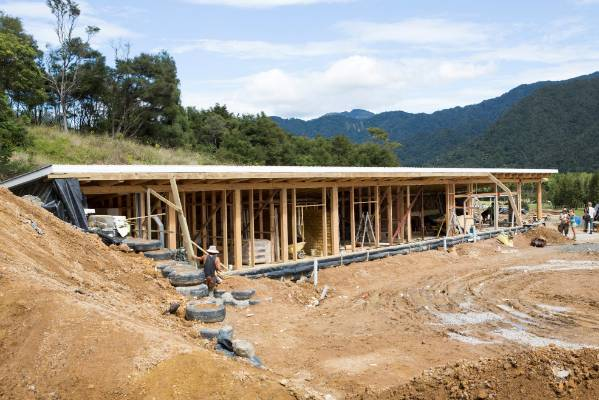 Costs were kept down on the construction of the Earthship thanks to volunteer labourers.