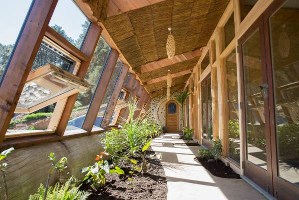 Most of the rooms in the Earthship open onto an internal garden walkway.
