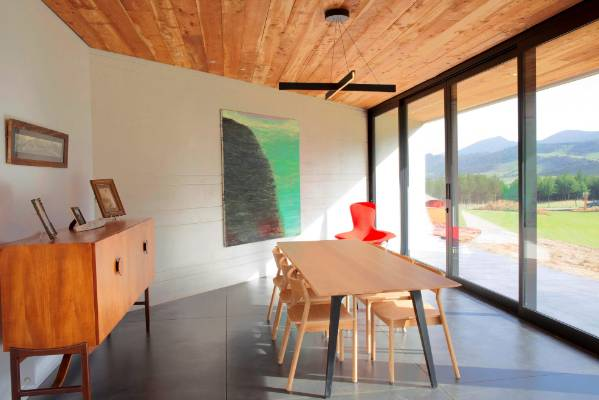 A Natural Timber Ceiling Adds Visual Warmth And Provides Counterpoint To The Concrete Walls