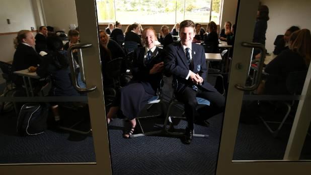 Mt Albert Grammar School prefect Grace Drummond, 18, and deputy head boy Fraser Polkinghorne, 17, both enjoy the glass ...
