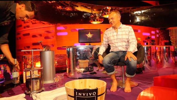 Invivo Wines co-founder Tim Lightbourne with Graham Norton on the set of his show getting ready to crush the grapes with ...