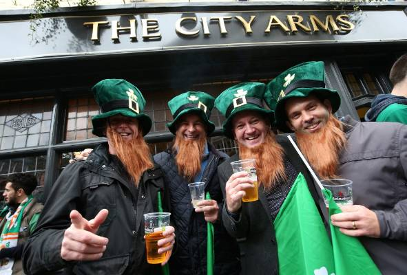 Ireland rugby fans enjoy some warm-up drinks ahead of the Rugby World Cup quarterfinal against Argentina in Cardiff.