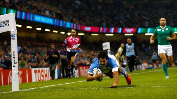 Matias Moroni dives over for the opening try of the Rugby World Cup quarterfinal between Argentina and Ireland.