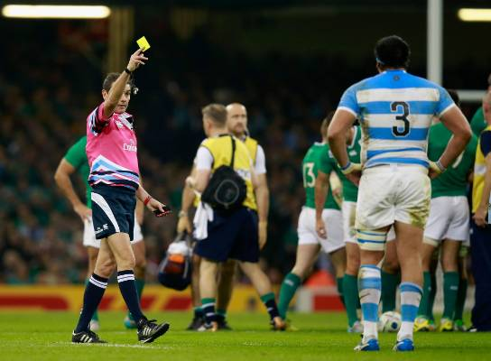 Referee Jerome Garces issues a yellow card to Ramiro Herrera of Argentina during the Rugby World Cup quarterfinal ...