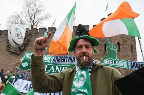 A vendor sells flags and scarves to fans close to the Millennium Stadium where Ireland play Argentina in the ...