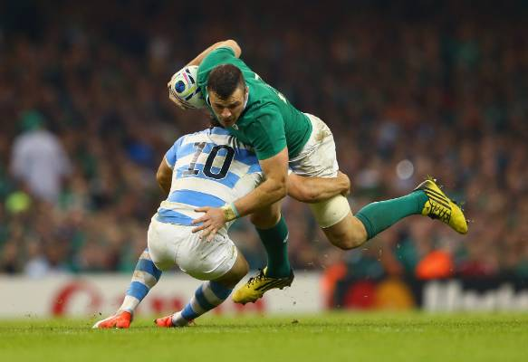 Ireland's Robbie Henshaw is tackled by Nicolas Sanchez of Argentina during their Rugby World Cup quarterfinal in Cardiff.