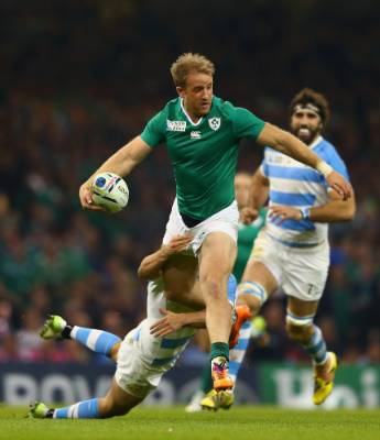 Ireland's Luke Fitzgerald passes the ball under pressure from Santiago Cordero of Argentina during their Rugby World Cup ...