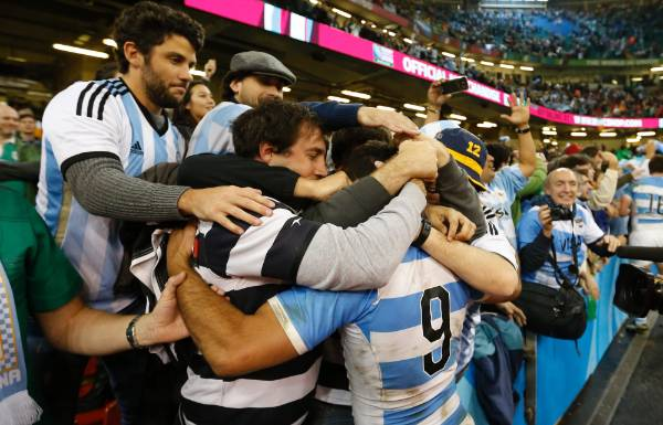 Argentina's Martin Landajo celebrates with fans after the Pumas beat Ireland in the Rugby World Cup quarterfinals.