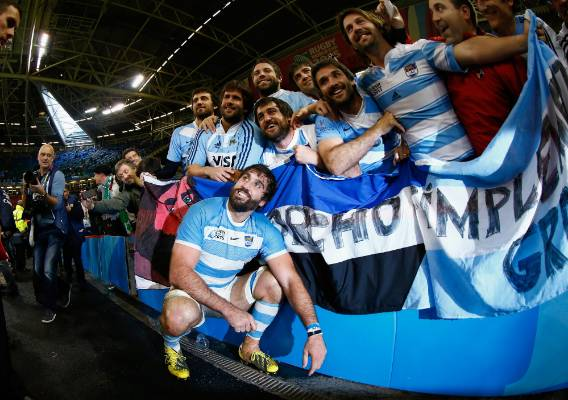 Argentina player Juan Martin Fernandez Lobbe celebrates with fans after beating Ireland in the Rugby World Cup quarterfinals.