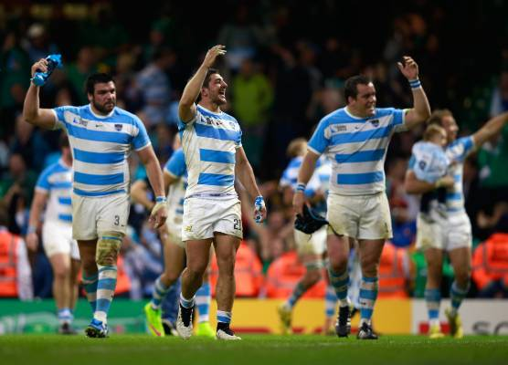 Tomas Cubelli, Ramiro Herrera and Marcos Ayerza celebrate victory in the Rugby World Cup quarterfinals.