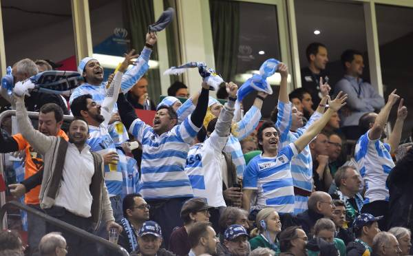 Argentina fans celebrate victory over Ireland at the Millennium Stadium in Cardiff.