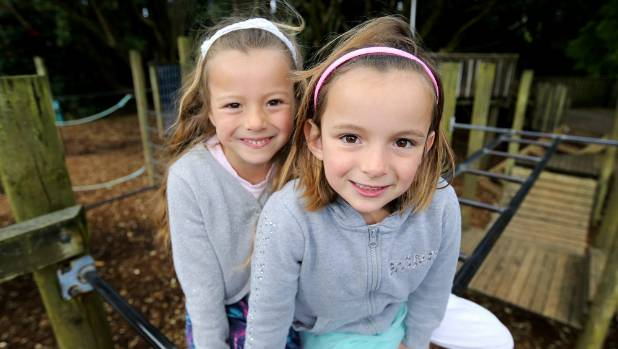 Omata School has seven sets of twins on its school roll this year. Twin sisters Samantha and Sophie Perrett, 6.