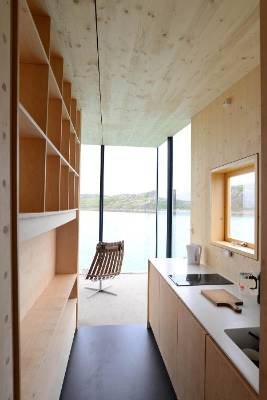 Natural wood features throughout the interiors, which have galley-style kitchens.